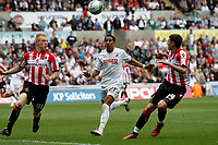 Npower Championship, Swansea City FC (white) V Sheffield United. Sat 7th May 2011 (12.45pm KO)<br /> Pictured: Scott Sinclair chases the bouncing ball as Shef Utd defenders Terry Kennedy (left) and Matthew Lowton (right)<br /> Picture by: Ben Wyeth / Athena Picture Agency<br /> info@athena-pictures.com<br /> 07815 441513