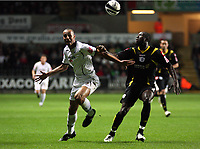 Pictured L-R: Darren Pratley of Swansea against Damion Stewert of Queens Park Rangers.<br /> Re: Coca Cola Championship, Swansea City Football Club v Queens Park Rangers at the Liberty Stadium, Swansea, south Wales 21st October 2008.