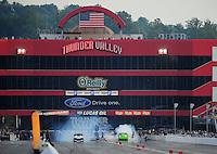 Jun. 18, 2011; Bristol, TN, USA: NHRA pro mod driver Leah Pruett-LeDuc (left) does a burnout alongside Chip King during qualifying for the Thunder Valley Nationals at Bristol Dragway. Mandatory Credit: Mark J. Rebilas-