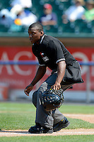 Umpire Malachi Moore during a game between the Lansing Lugnuts and Dayton Dragons on August 25, 2013 at Cooley Law School Stadium in Lansing, Michigan.  Dayton defeated Lansing 5-4 in 11 innings.  (Mike Janes/Four Seam Images)