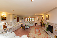 BNPS.co.uk (01202 558833)<br /> Pic: Savills/BNPS<br /> <br /> Pictured: The spacious living room with a fireplace.<br /> <br /> A historic thatched home where Cromwell's army stayed during the English Civil War is on the market for £1.6m.<br /> <br /> The Barracks, so-named for its links with Cromwell more than 370 years ago, has spectacular country views and is in one of Cheshire's most popular areas.<br /> <br /> The five-bedroom property just outside the picturesque village of Bunbury is a far cry from how it would have looked in Cromwell's time, having been extended over the years.<br /> <br /> It was used in the 17th century by Cromwell's armies during the siege of Beeston Castle - two miles away. The castle's location made it valuable to both the royalists and parliamentarians.