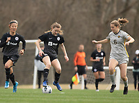 LOUISVILLE, KY - MARCH 13: Emina Ekic #13 of Racing Louisville FC maneuvers the ball during a game between West Virginia University and Racing Louisville FC at Thurman Hutchins Park on March 13, 2021 in Louisville, Kentucky.