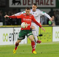 SV Zulte-Waregem - RSC Anderlecht :..Teddy Chevalier (links) beschermt de bal voor Jan Polak (rechts)..foto VDB / BART VANDENBROUCKE