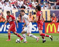 Carlos Bocanegra (3) of the USMNT splits the defense of Tuncay Sunli (10) and Sabri Sariogulu (25) of Turkey at Lincoln Financial Field in Philadelphia, PA.  The USMNT defeated Turkey, 2-1.
