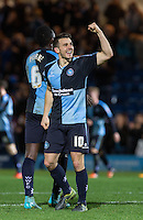 Matt Bloomfield of Wycombe Wanderers punches the air following victory during the Sky Bet League 2 match between Wycombe Wanderers and Oxford United at Adams Park, High Wycombe, England on 19 December 2015. Photo by Andy Rowland.