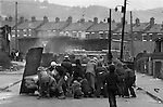 Ireland The Troubles. Belfast hijacked lorry set on fire by young IRA trouble makers and used as a barricade in petrol bomb fight against the British army seen in background. 1980s Probably taken in Etna Drive, Ardoyne north Belfast.