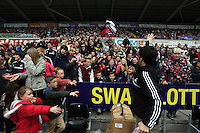 Wednesday, 23 April 2014<br /> Pictured: Free scarves given to supporters.<br /> Re: Swansea City FC are holding an open training session for their supporters at the Liberty Stadium, south Wales,
