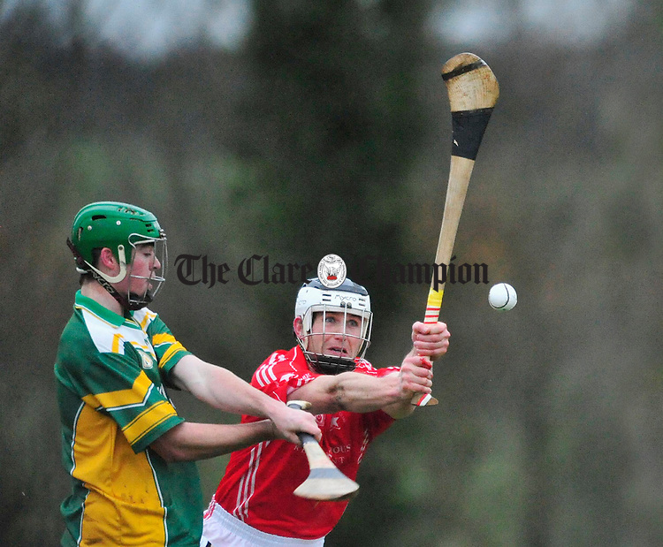 Bruff's Mick O' Hara blocks a shot from Cathal Chaplin of Broadford. Photograph by Declan Monaghan