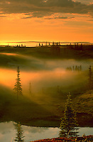 An autumn mist and sunset over and area called The Barrens with the head waters of the Thelon River in the foreground. Northwest Territory of Canada.