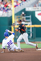 Miami Hurricanes second baseman George Iskenderian (7) records a force out as Florida Gators baserunner JJ Schwarz (22) slides into second base during the NCAA College World Series on June 13, 2015 at TD Ameritrade Park in Omaha, Nebraska. Florida defeated Miami 15-3. (Andrew Woolley/Four Seam Images)