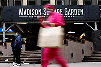 NEW YORK - NEW YORK - APRIL 02: People walk in front of Madison Square Garden on April 02, 2021 in New York. New York takes another step forward to reopening arts and entertainment, venues are allowed to welcome back people with the guidelines say indoor spaces can have up to 100 audience members and outdoor venues can have 200. (Photo by John Smith/VIEWpress)