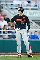 Miami Hurricanes outfielder Willie Abreu (13) on deck against the Florida Gators in the NCAA College World Series on June 13, 2015 at TD Ameritrade Park in Omaha, Nebraska. Florida defeated Miami 15-3. (Andrew Woolley/Four Seam Images)