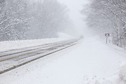Vehicles on the Kancamagus Highway (route 112) during blizzard conditions in the White Mountains, New Hampshire.