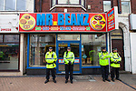 © Joel Goodman - 07973 332324 . 28/05/2011 . Blackpool, UK . Police guard takeaway Mr Beanz . About 2,000 people attend an English Defence League demonstration. The EDL say the protest was organised after the failed prosecution of local takeaway owners who they allege are responsible for the disappearance and suspected murder of 14 year old Charlene Downes. Photo credit : Joel Goodman