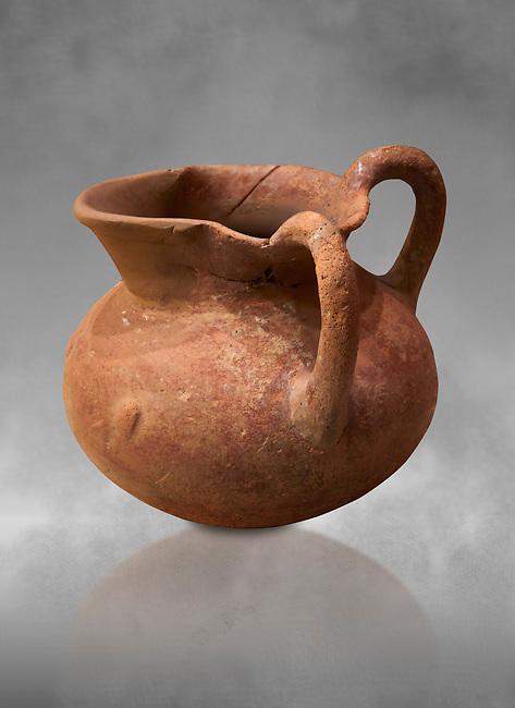 Hittite terra cotta two handled pitcher. Hittite Period, 1600 - 1200 BC.  Hattusa Boğazkale. Çorum Archaeological Museum, Corum, Turkey. Against a grey bacground.. Against a grey bacground.