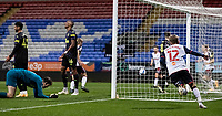Bolton Wanderers' Jak Hickman (right) runs off to celebrate scoring his side's first goal as Newcastle United U21's goalkeeper Daniel Langley (left) despairs<br /> <br /> Photographer Andrew Kearns/CameraSport<br /> <br /> EFL Papa John's Trophy - Northern Section - Group C - Bolton Wanderers v Newcastle United U21 - Tuesday 17th November 2020 - University of Bolton Stadium - Bolton<br />  <br /> World Copyright © 2020 CameraSport. All rights reserved. 43 Linden Ave. Countesthorpe. Leicester. England. LE8 5PG - Tel: +44 (0) 116 277 4147 - admin@camerasport.com - www.camerasport.com