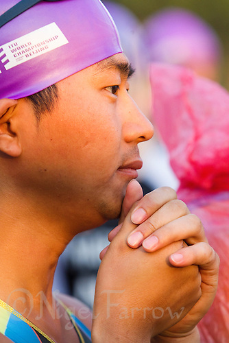 11 SEP 2011 - BEIJING, CHN - A competitor waits for the start of his wave at the 2011 ITU World Age Group Olympic Distance Triathlon Championships (PHOTO (C) NIGEL FARROW)