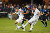 SAN JOSE, CA - MARCH 7: Andy Rios #25 of the San Jose Earthquakes battles for the ball with Osvaldo Alonso #6 and Chase Gasper #77 of Minnesota United during a game between Minnesota United FC and San Jose Earthquakes at Earthquakes Stadium on March 7, 2020 in San Jose, California.