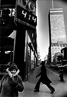 April 1st, 1975 File Photo - Passerby walk at the corner of Peel and Sainte-Catherine in downtown Montreal.