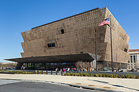 Visitors wait in line to enter the Smithsonian National Museum of African American History and Culture in Washington, DC.