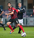 Dundee's Paul McGowan pulls at St Johnstone's Simon Lappin.