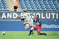 FOXBOROUGH, MA - APRIL 17: Hernan Gonzalez #19 of Richmond Kickers collides with Luis Caicedo #27 of New England Revolution II during a game between Richmond Kickers and Revolution II at Gillette Stadium on April 17, 2021 in Foxborough, Massachusetts.