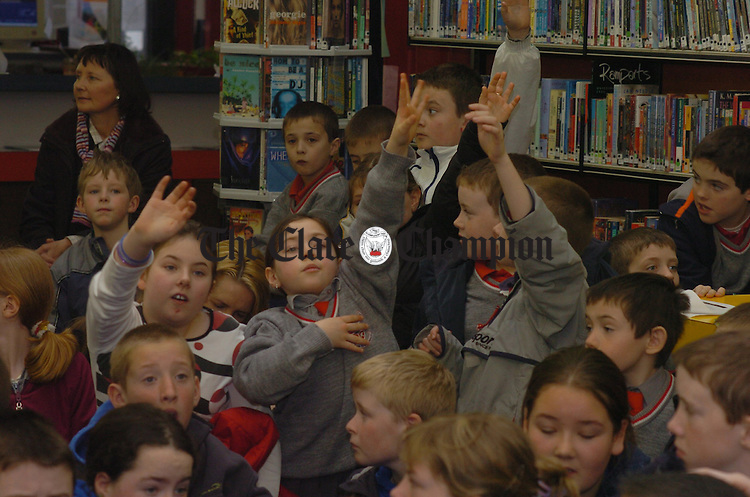 Me me me....Children raise their hands to question author Cora Harrison durting her visit to the de Valera Library Ennis as part of National Book Day. Photograph by John Kelly.