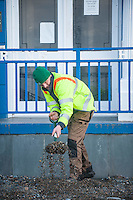 Aberystwyth, Wales, UK. Tuesday 09 February 2016<br />Pictured: A council worker clears debris from the coastal road.<br />Re: The clean up begins in Aberystwyth, west Wales after storm Imogen hit parts of the UK.