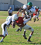 Football action. Defenders break up a pass play.