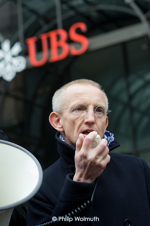 Jerry Hicks, of UNITE, speaks at a rally in support of Alberto Durango, a member of UNITE and the Latin American Workers Association, outside the London headquarters of Swiss bank UBS, where he worked as a cleaner until being sacked by contractor Lancaster Cleaning and Support Services following a campaign for improved pay and conditions.