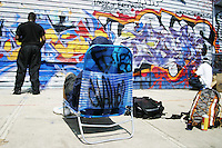 Graffiti artists work at the complex known as Five Pointz in Queens, NY on July 19, 2003.