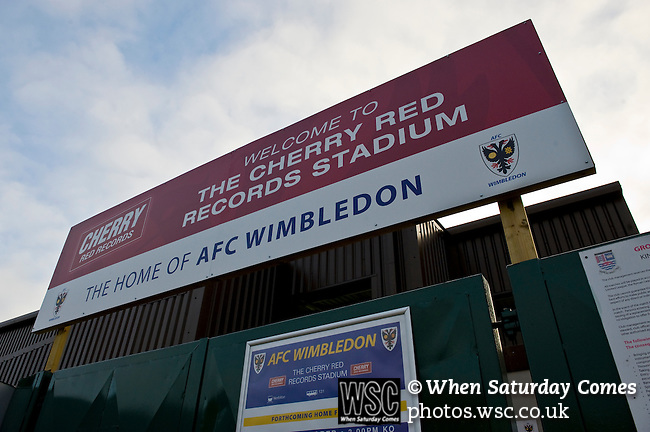 AFC Wimbledon 4 Portsmouth 0, 16/11/2013. Kingsmeadow, League Two. Wimbledon and Portsmouth have had turbulent histories and both supporter-owned clubs are now in League Two. Kingsmeadow (known as The Cherry Red Records Stadium for sponsorship purposes)  Photo by Simon Gill.