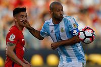 Action photo during the match Argentina vs Chile at Levis Stadium Copa America Centenario 2016. ---Foto  de accion durante el partido Argentina vs Chiler, En el Estadio de la Universidad de Phoenix, Partido Correspondiante al Grupo - D -  de la Copa America Centenario USA 2016, en la foto:  (i)-(d) Charles Aranguiz, Javier Mascherano<br /> --- 06/06/2016/MEXSPORT/PHOTOSPORT/ Andres Pina