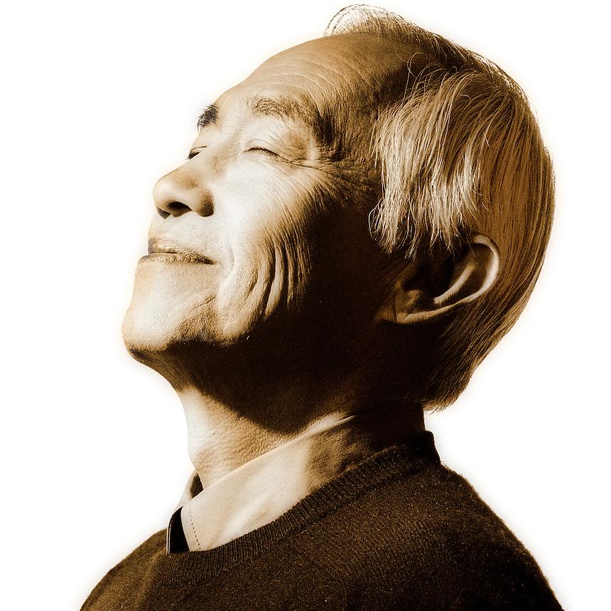 Contemplative Asian man.