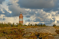 Storm clouds fly over the colorful rocks & flora of Isokari Island -Southwestern Finland.