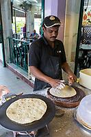 Restaurant Cook making Roti, Ipoh, Malaysia.