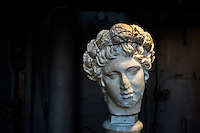 Female head sculpture exhibited in the Hall of the Machines. Centrale Montemartini. Rome, Italy. Mar. 07, 2015