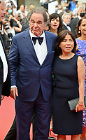 CANNES, FRANCE. July 12, 2021: Oliver Stone & Sun-jung Jung  at the gala premiere of Wes Anderson's The French Despatch at the 74th Festival de Cannes.<br /> Picture: Paul Smith / Featureflash