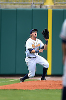 Montgomery Biscuits outfielder Taylor Motter (10) chases down a fly ball into the bullpen during a game against the Mississippi Braves on April 22, 2014 at Riverwalk Stadium in Montgomery, Alabama.  Mississippi defeated Montgomery 6-2.  (Mike Janes/Four Seam Images)