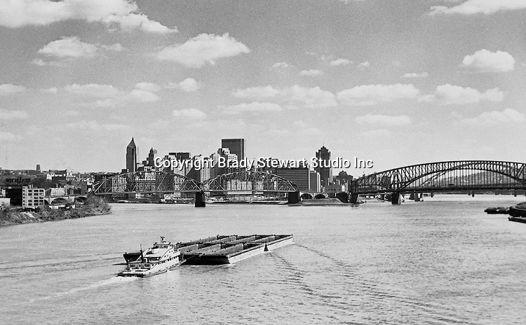 Pittsburgh PA:  Looking up the Ohio River toward the Point from the West End Bridge.  Pittsburgh Hilton is under construction.