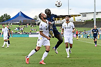 3rd January 2021; Campbelltown Stadium, Leumeah, New South Wales, Australia; A League Football, Macarthur FC versus Central Coast Mariners; Ivan Franjic of Macarthur FC and Alou Kuol of Central Coast Mariners compete for the high ball