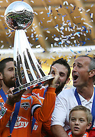 Houston coach Dominic Kinnear and captain Wade Barrett with the Alkan I. Rothenberg trophy. The Houston Dynamo defeated the New England Revolution 2-1 in the finals of the MLS Cup at RFK Memorial Stadium in Washington, D. C., on November 18, 2007.