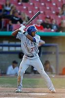 Addison Russell #27 of the Stockton Ports bats against the High Desert Mavericks at Stater Bros. Stadium on April 27, 2013 in Adelanto, California. Stockton defeated High Desert, 17-7. (Larry Goren/Four Seam Images)