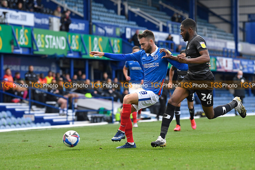 Ben Close of Portsmouth left holds off Cameron John of Doncaster Rovers during Portsmouth vs Doncaster Rovers, Sky Bet EFL League 1 Football at Fratton Park on 17th October 2020