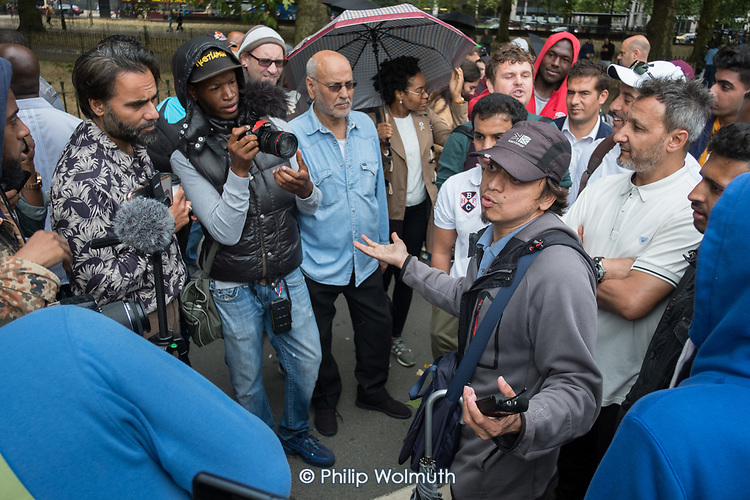 Religious argument, Speakers' Corner, Hyde Park, London, where the use of video cameras and smartphones to record speakers, preachers, sermons and arguments, for broadcast via social media, has become widespread in recent months.