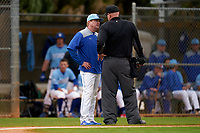 Indiana State Sycamores head coach Mitch Hannahs argues a call with the umpire during a game against the Dartmouth Big Green on February 21, 2020 at North Charlotte Regional Park in Port Charlotte, Florida.  Indiana State defeated Dartmouth 1-0.  (Mike Janes/Four Seam Images)