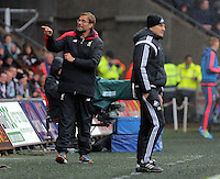 (L-R) Liverpool manager Jurgen Klopp and Swansea head coach Francesco Guidolin during the Barclays Premier League match between Swansea City and Liverpool at the Liberty Stadium, Swansea on Sunday May 1st 2016