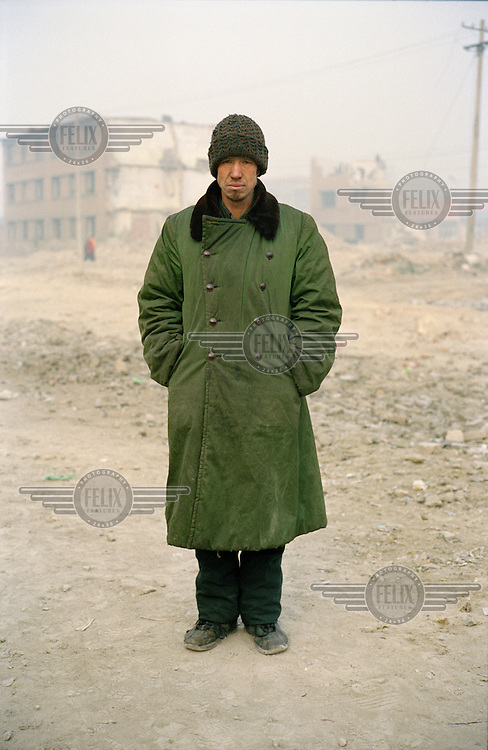 A coal seller. He spends his days distributing coal to various shops and homes in the area.  Shanxi is the largest producer of coal in China.