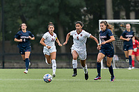 NEWTON, MA - AUGUST 29: Sonia Walk #5 of Boston College brings the ball forward as Cara Jordan #26 of University of Connecticut closes during a game between University of Connecticut and Boston College at Newton Campus Soccer Field on August 29, 2021 in Newton, Massachusetts.