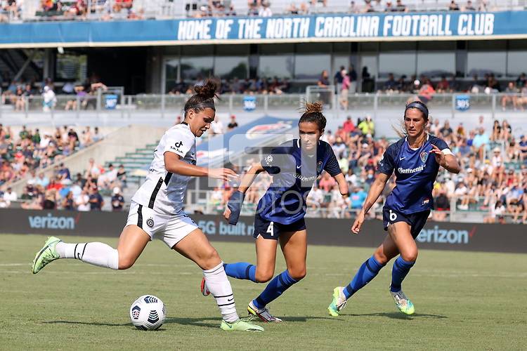 CARY, NC - SEPTEMBER 12: Sophia Smith #9 of the Portland Thorns FC is defended by Carson Pickett #4 and Abby Erceg #6 of the North Carolina Courage during a game between Portland Thorns FC and North Carolina Courage at Sahlen's Stadium at WakeMed Soccer Park on September 12, 2021 in Cary, North Carolina.